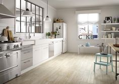 Want the practicality of porcelain floor tiles, but crave the warm look of wood? Thanks to developments in digital printing, new wood-effect ceramic tiles look more realistic than ever before and are perfect for giving your kitchen a welcoming look. Wood Effect Floor Tiles, Wood Effect Porcelain Tiles, Tile Floor, Wood Tiles, Porcelain Floor, Wood Flooring, Küchen Design, Floor Design, Kitchen Tiles