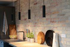 Three black pendant lights with brass detail #steel #oplys #pendants #lamps #light #design #danish #nordic #scandinavia