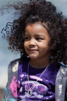 Closeup of Cute little African American Hispanic girl with curly hair blowing by mikebaird, via Flickr