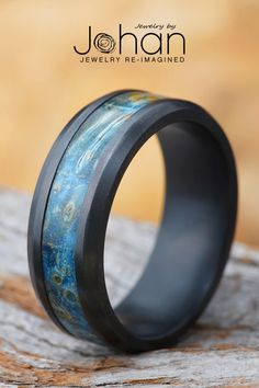Blue box elder burl lines the inlay of this beveled black zirconium wedding band from #JewelyrbyJohan