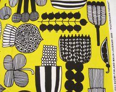 Marimekko fabric, yellow/black Puutarhurin parhaat, 145x30cm by Maija Louekari