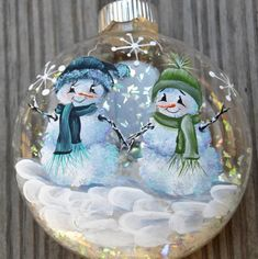 These two snowmen are hand painted on a clear glass ornament. This ornament would be great for couples and children alike. Snowman Christmas Ornaments, Felt Christmas Decorations, Christmas Balls, Christmas Art, Celtic Christmas, Christmas Globes, Clear Glass Ornaments, Hand Painted Ornaments, Glitter Ornaments