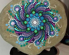 Large hand painted stone From the shores of Lake Erie Size: approx. inches in diameter Protective UV resistant varnish so colors will not fade Rock Painting Patterns, Dot Art Painting, Rock Painting Designs, Mandala Painting, Pebble Painting, Mandala Art, Stone Painting, Mandala Painted Rocks, Painted Rocks Craft