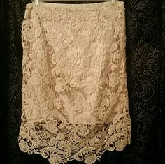 FABULOUS CLASSY AND SEXY SKIRT!  ?? This skirt  is absolutely gorgeous! With a beautiful lace detailed outer, and satin lining, it is fabulous! Ladies, this is too sexy and classy, for words! You can tell how nice it is just by the detail around the waistband. Any questions, let me know Skirts