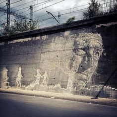 by #Vhils Milestone Project, Girona, Spain 2012