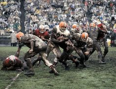 Browns running back Jim Brown scrambles past the 49ers defense during a muddy game in Dec. 1962. (Neil Leifer/SI)