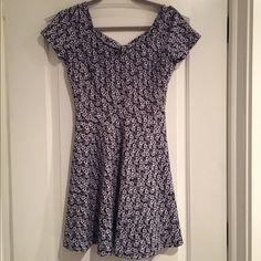 Maitai dark blue floral dress Maitai short/cap sleeve dark blue floral dress. With bow and key hole opening in back. Stretchy material. No zipper. Never worn. Maitai Dresses