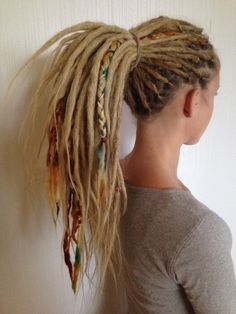 Dreadlocks with yarn braids as decorations