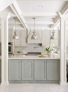 Perimeter cabinets are Sherwin Williams Wool Skein and island is Sherwin Williams Topsail