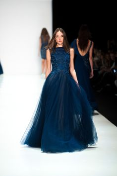 SS15 collection on the runway. Midnight Blue evening gown with embroidered bodice, boat neckline and a Tulle skirt