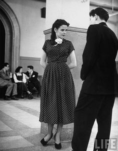 madeline balcar, 16 year old model -  wearing a classic simple blue polka-dot dress. 1949.