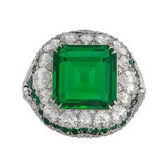 Untreated 4.31 Carat Emerald Diamond Platinum Ring