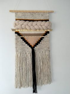 Unique woven wall hanging in natural warm tones, incorporating wool, cotton, ribbon, roving and other accent fibres. This piece measures approx 10 inch in width x 23 inch in length and hung onto a wooden dowel rod.  A stylish boho inspired weave in earthy tones with golden highlights. An ideal contemporary piece for any modern home. Custom order notes - estimated dispatch time within 2 weeks.   Take a look at my instagram gallery @bybelladesigns for a sneek peek at new designs