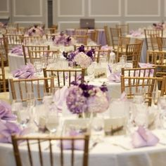 All different shades of purple make this daytime wedding .