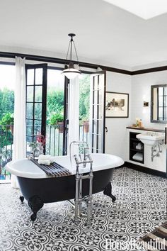 Industrial chic black and white bathroom - including a claw foot tub.