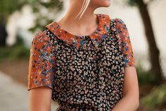 Such a pretty mix of florals and colors. peplum. collar.