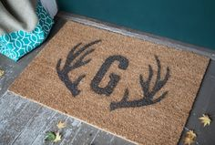 Stenciled Monogram and Antler Rug by Lia Griffith