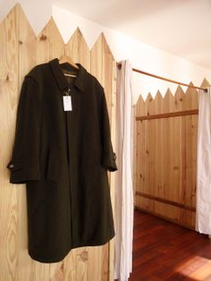 Overcoat on the fence!