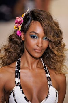 """The Look: '70s Holiday How-To: Beauty got personal at DVF, where the inspiration behind the tropical hair and makeup was none other than a '70s photograph of the designer herself, embracing her curls for a night out on the town. """"It's a nod to the first time Diane went out and left her hair curly—actually, I think it was the first time she went to Studio 54,"""" said Pat McGrath, who recreated a look she previously did on Sophie Dahl for Italian Vogue. """"She [DVF] loved the idea of blues and…"""