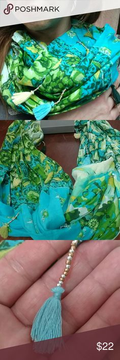Infinity scarf with beaded tassels Beautiful sea green, teal, yellow, blue, and ivory floral print fabric, embellished with silver and gold seed beads holding teal, sea green, and yellow tassels.  This scarf can be worn several different ways and the tassels add a boho style beauty. Accessories Scarves & Wraps