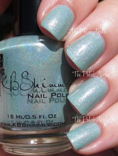 Mint-al Vacation is a light blue/green holo with a pretty white shimmer.