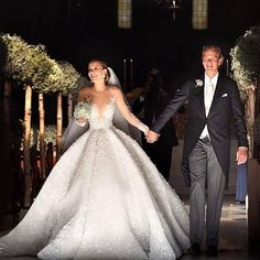 "d8ee05a076dd ... Instagram  ""The stunning Swarovski heiress VICTORIA SWAROVSKI   victoriaswarovski wears a 6-meter train crystallized couture MICHAEL CINCO wedding  gown…"""