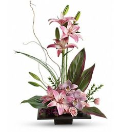 Bi-focus arrangement~ composition of pink lilies, pink orchids and pink roses is memorably tranquil. A modern, square black dish is filled with just the right number of Zen tropical flowers, grasses and leaves. Orchid Flower Arrangements, Modern Floral Arrangements, Creative Flower Arrangements, Ikebana Flower Arrangement, Church Flower Arrangements, Church Flowers, Beautiful Flower Arrangements, Funeral Flowers, Beautiful Flowers