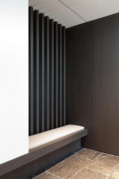 oyer wbuilt-in/flush with wall bench and coat closet. Designed by iXtra Interior Achritecture.