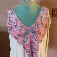 """Free People Shirt Creme colored cotton with floral design on front shoulders tie up and adjust with strap across back is 29""""long looser fitting Free People Tops"""