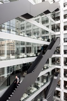 OMA has completed restructured a governmental office building from the 1990s, creating all-new types of workspaces for the Dutch ministries that occupy it
