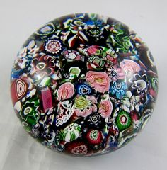 "Clichy ""End-of-Day"", or ""Scatter,"" millefiori glass paperweight with several full and partial cabbage rose canes, ca. 1850. $1,750.00"