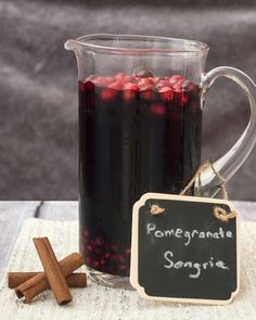 Pomegranate sangria combines fruity red wine with pomegranate and cranberry, with cinnamon for a hint of spice. Make a large batch a day ahead for a winning party cocktail! #SundaySupper TheRedheadBaker.com