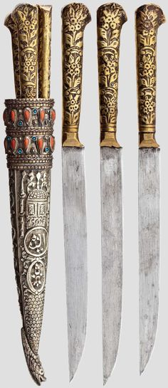 Ottoman, mid-19th century. Three-piece kard dagger / knife set with single-edge blade back, the handles in relief brass sheet. Sheath rich in relief and chiselled silver, the top ending in an animal head. At the upper edge trimming of coral and turquoise (Turquoise some missing). Length 31.5 cm.