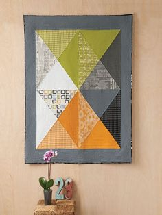Create a striking addition to your home decor when you make the Hourglass Wall Quilt designed by Brigitte Heitland. Customized the quilt to your color scheme by experimenting with a variety of fabric combinations.
