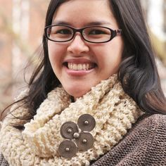 This rustic knit infinity scarf has a simple construction, intended to showcase the chunky wool and metal embellishment.