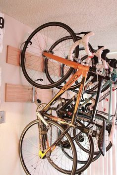 Several bicycles hanging bike wall mount