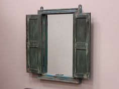 Vintage Up-Cycled Blue Shuttered Mirror   This wonderful vintage blue painted teak mirror is made and up-cycled from an authentic reclaimed antique window shutter.  Ideal as an iconic feature in your home…above a fireplace, in an ornate hallway, in a bathroom or in an elegant bedroom.  http://www.scaramangashop.co.uk/at-home/home-accents/wooden-mirrors/vintage-up-cycled-blue-shuttered-mirror/prod_6460.html