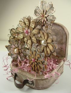 Altered chipboard suitcase full of flowers