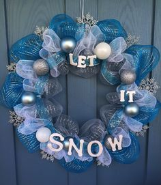 - Wire wreath frame covered with silver, blue and white mesh, silver shimmery snowflakes and blue and silver snowflake ribbon. - This wreath is decorated with matte blue, glittered silver and white or Frozen Christmas Tree, Winter Christmas, Christmas Ideas, Christmas Time, Holiday Ideas, Snowman Wreath, Diy Wreath, Wreath Ideas, Christmas Mesh Wreaths