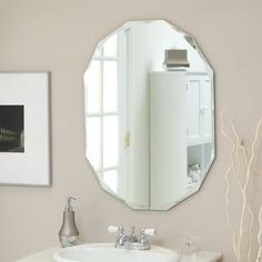 Décor Wonderland Frameless Diamond Wall Mirror - 23.5W x 31.5H in. - Reflect your home's beauty in the Frameless Diamond Wall Mirror. This beautiful oval mirror has a clean, elegant style. Constructed of metal and stron...