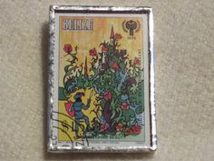 Postage Stamp Brooch: Sleeping Beauty by bookshelvesofdoom on Etsy, $16.50