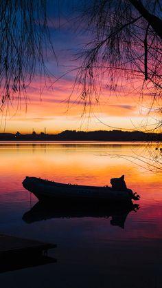 Boat at sunset  source Flickr.com