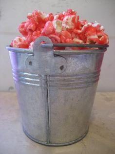 Cinnamon Candy Popcorn (with Cinnamon Oil).   I used puff corn, too.  Delicious!