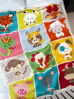 My large and colorful Zoodiacs C2C Crochet Afghan - 12 squares depicting the 12 animals in the Chinese Zodiac, worked with c2c crochet and joined together.