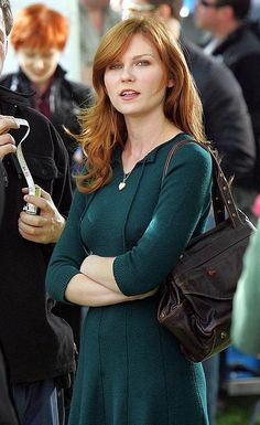 People tell me I look like her? But I am older and had red hair first, so she looks like me ;) But our styles are nothing alike...