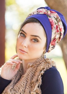 Pre-sewn, turban style head covering in blue, petrol, and pink. Made of crepe and chiffon materials, and decorated with a blue teardrop stone. Just place this head covering on your head and tie- no wrapping involved!