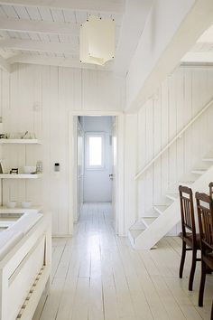 White wood floors, white wood walls, white wood ceiling.