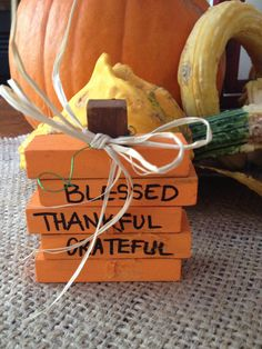 Using Jenga type blocks, cubes, raffia and twisty wire (all from the dollar store) create a thanksgiving pumpkin!