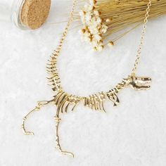 Aliexpress.com: Comprar Moda Plata Oro Negro dinosaurio plateada del diseño del cráneo del suéter del collar corto de collar de recuerdo confiables proveedores de sunnyitem store.