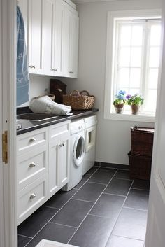 Black and white laundry room. I have a new love....plank tiles. I need some!